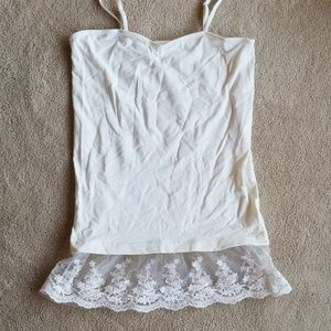 $3 if bundled. Poof ivory camisole w/lace bottom.